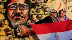Egitto le purghe staliniane: un murale anti-Morsi nelle strade del Cairo.